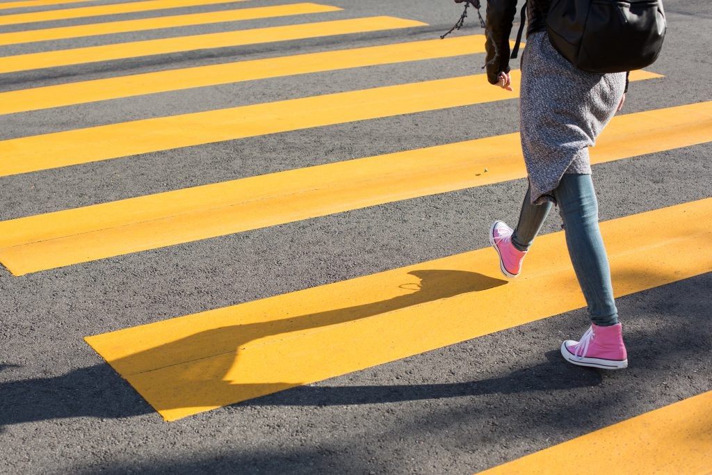 girl-crossing-street-on-a-yellow-crosswalk-picjumbo-com