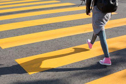 girl-crossing-street-on-a-yellow-crosswalk-picjumbo-com